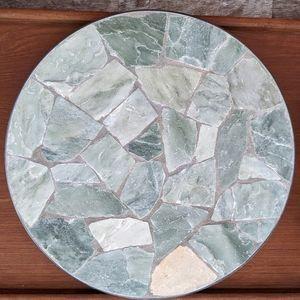 Rock mosaic riser plate